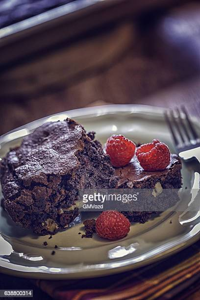 Chocolate Brownies with Raspberries Served on a Plate