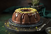chocolate bundt cake with chocolate glaze and pistachios