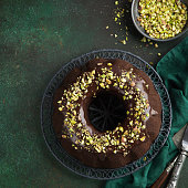 chocolate bundt cake with chocolate glaze and pistachios, top view