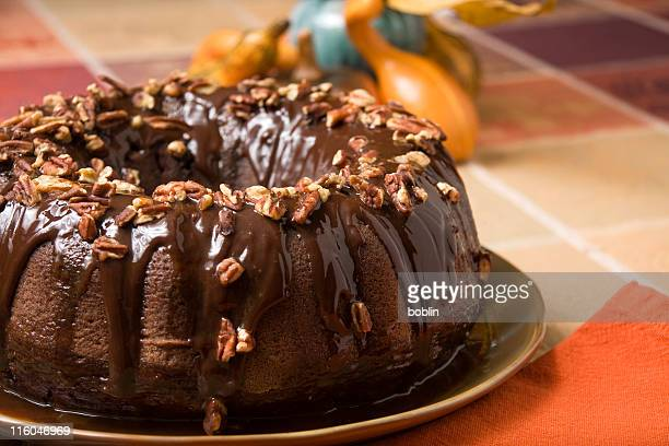 Chocolate cake covered with nuts