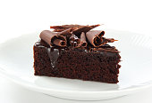 Delicious chocolate cake decorated with shavings of chocolate.