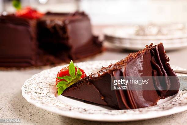 Chocolate Cake slice with Strawberries in domestic kitchen