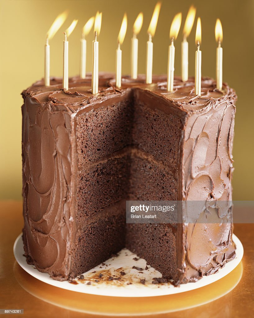 Chocolate Cake With Birthday Candles Stock Photo Getty ...