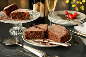chocolate cake with champagne beside - closeup