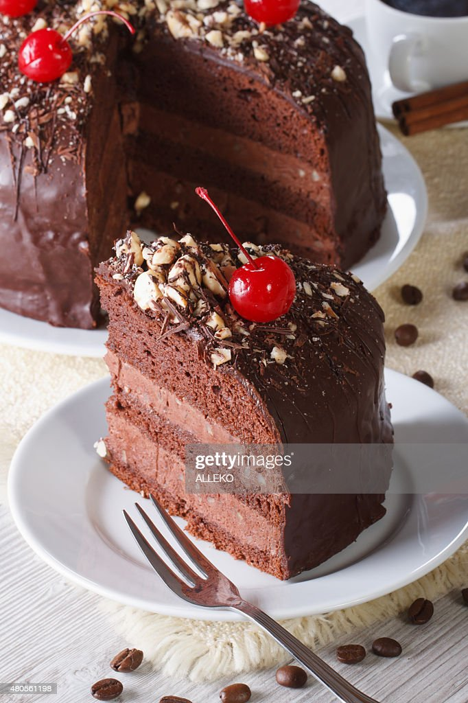 chocolate cake with cherry and a piece. Vertical : Stock Photo