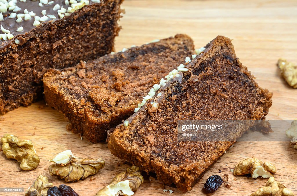 Chocolate cake with delicacies on wooden table. : Stock Photo
