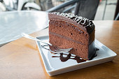 Piece of chocolate cake with warm chocolate syrup(soft focus)