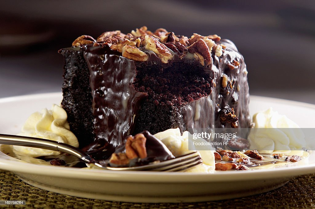 Chocolate cake with whipped cream and walnuts : Stock Photo