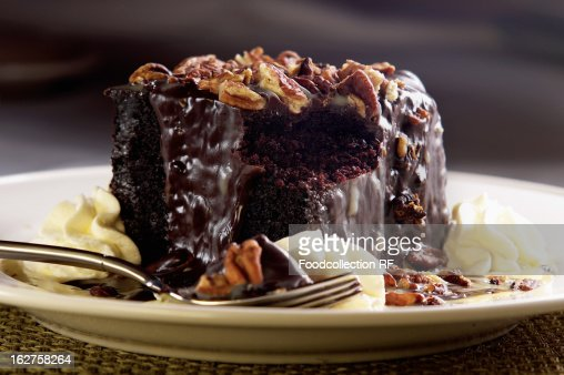 Chocolate Cake With Whipped Cream And Walnuts Stock Photo | Getty ...