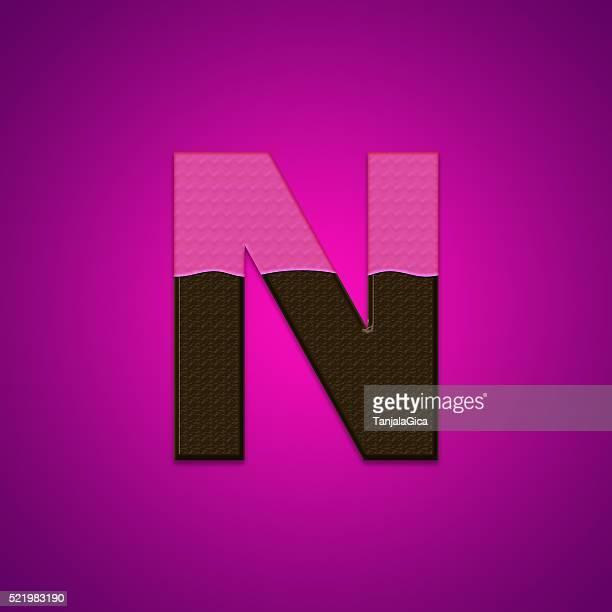 Lettres de bonbons et de chocolat isolé sur fond rose