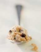 Chocolate chip cookie dough on a spoon