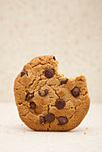 Chocolate chip cookie with a bite missing