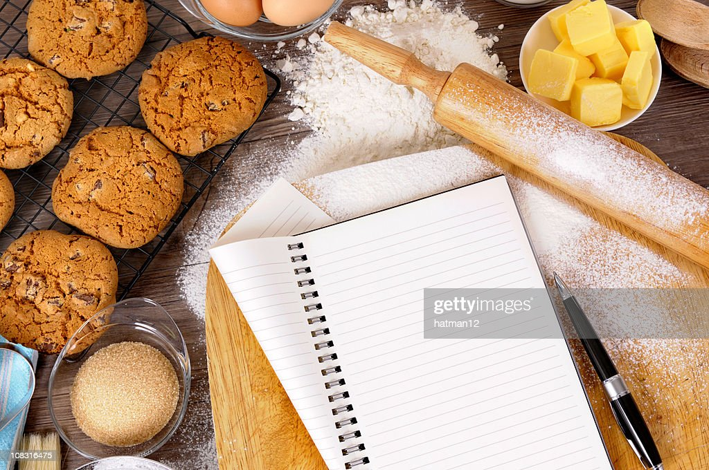 Chocolate chip cookies with ingredients and notebook