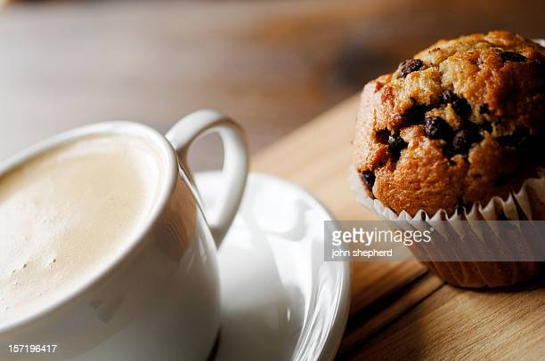 chocolate chip muffin and cup of coffee