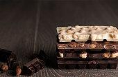 Chocolate / Chocolate bar on dark wooden background