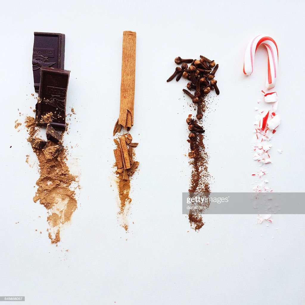 Chocolate, cinnamon, cloves, and candy cane, whole at top, crushed below
