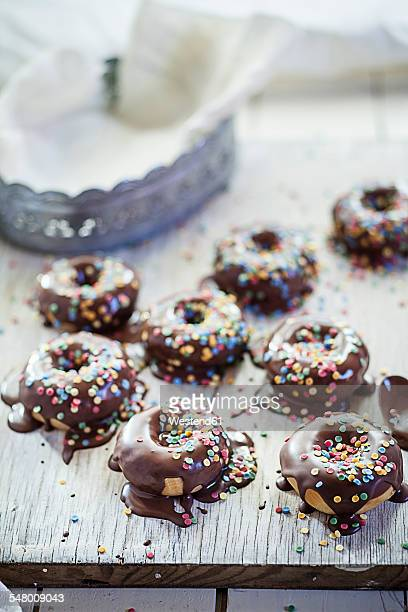 Chocolate covered donuts with sugar sprinkles, studio