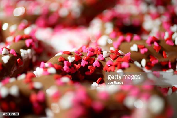 Chocolate covered pretzels with little candy hearts sprinkled on top are seen as the Le Chocolatier fine chocolate store prepares for a Valentine's...