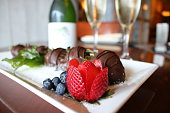 Sweet chocolate covered strawberries with sparkling wine