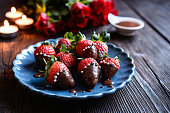 Delicious chocolate covered strawberries, decorated with silver sprinkles for Valentine's Day