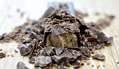 chocolate crumbs on wood background,image of a