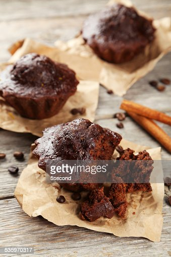 Chocolate cupcake on grey wooden background : Stock Photo