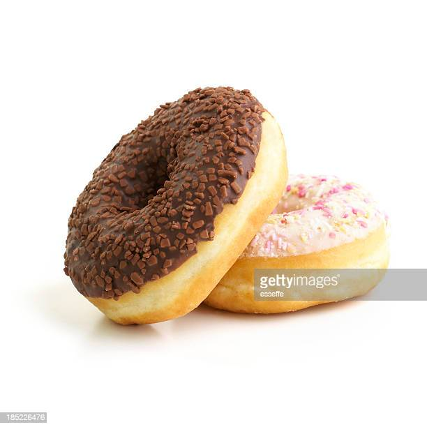 Chocolate donut sitting on a vanilla donut