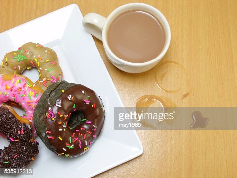 chocolate donuts on a plate on wooden background : Stock Photo