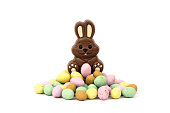 Chocolate easter bunny on top of chocolate eggs