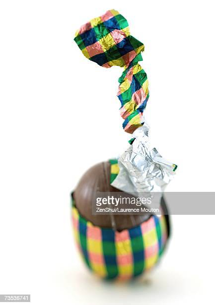 Chocolate egg, partially unwrapped