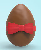 Chocolate egg with a red bow. Easter concept. Close up. 3D illustration