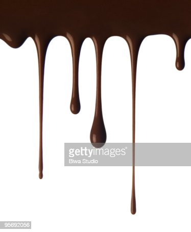 Chocolate falling in drops : Stock Photo