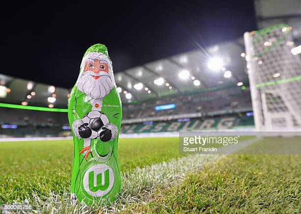 A chocolate father christmas dressed in the colours of Wolfsburg waits by the pitch prior to the Bundesliga match between VfL Wolfsburg and Borussia...