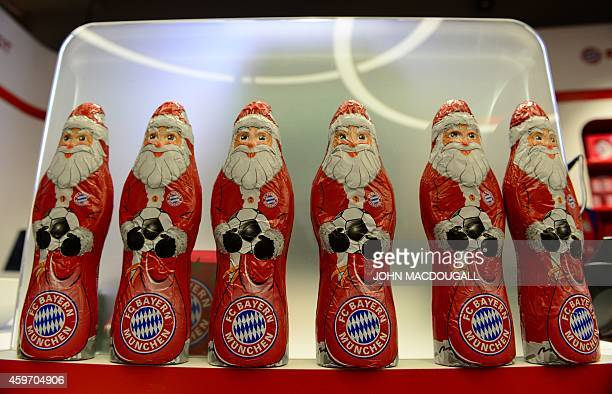 Chocolate Father Christmas figures bearing the logo of German first division Bundesliga football club FC Bayern Muenchen are on display in Bayern...