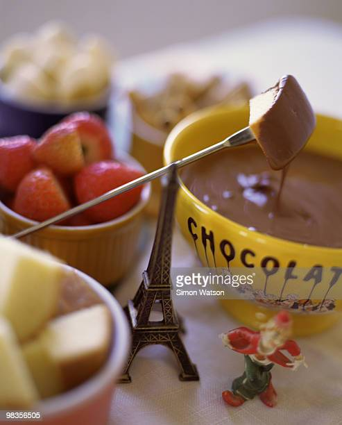 Chocolate fondue with pound cake and strawberries