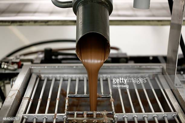 Chocolate for Cadbury Creme Eggs is poured into a vat at the Bournville Cadbury factory operated by Mondelez International Inc in Birmingham UK on...