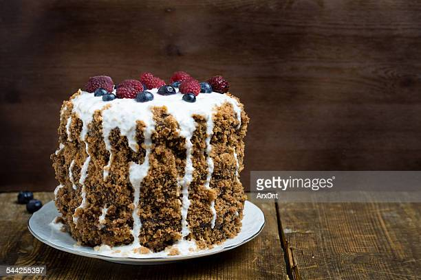 Chocolate gingerbread cake on wooden table