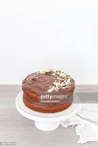 Chocolate hazelnut cake on a cake stand