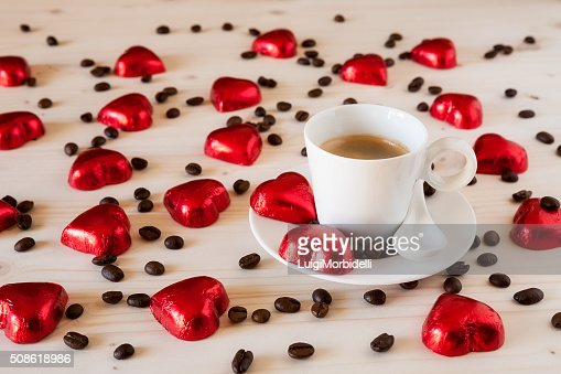 Chocolate hearts and coffee beans on a table : Stock Photo