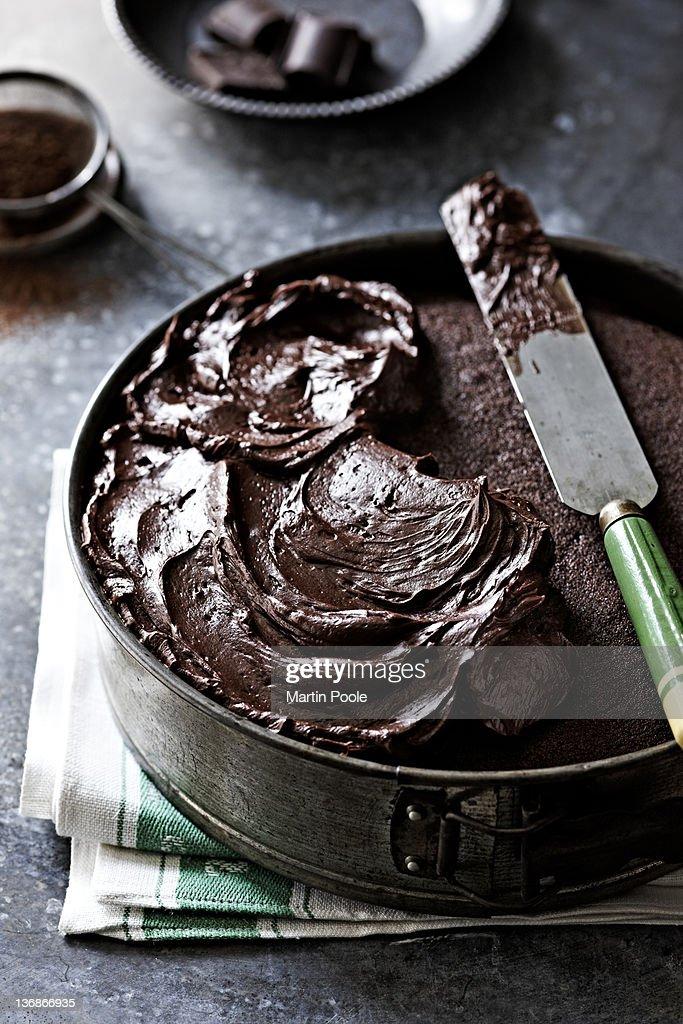 chocolate icing on a chocolate cake