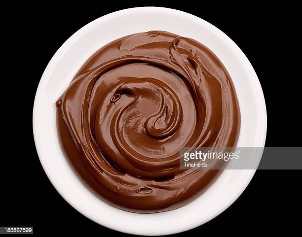 Chocolate icing on white plate