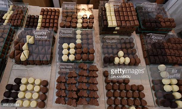 Chocolate is on display in a shop of 'La maison du chocolat ivoirien' on March 30 2015 in Abidjan Ivory Coast reigns as the world's top cocoa...