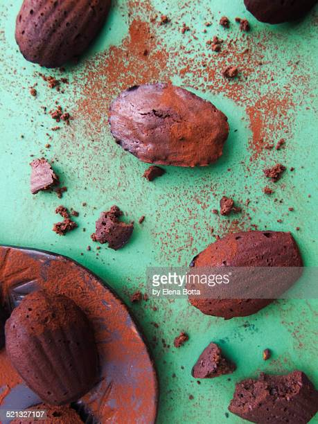 Chocolate madeleines and cocoa powder