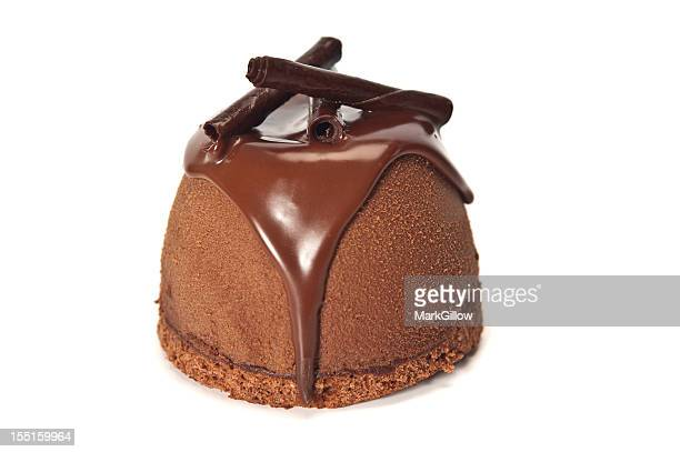 Chocolate mousse bomb desert over a white background