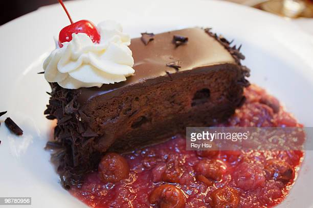Chocolate mousse cake served with cherry chutney