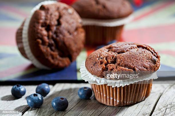 Chocolate muffins and blueberries on wood, English flag