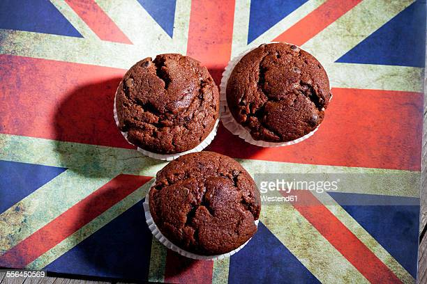 Chocolate muffins on chopping board with English flag