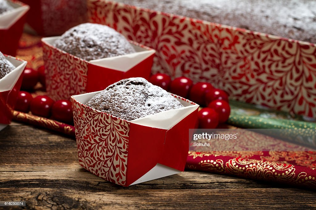 Chocolate muffins sprinkled with powdered sugar : Stock Photo