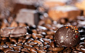 Chocolate pieces and coffee beans close up background