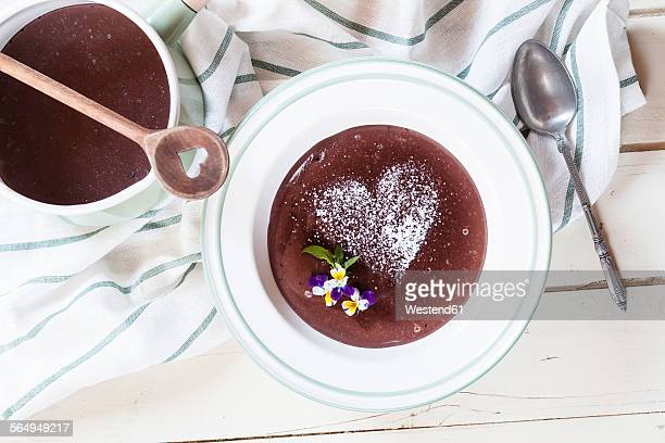 Chocolate pudding decorated with edible flowers